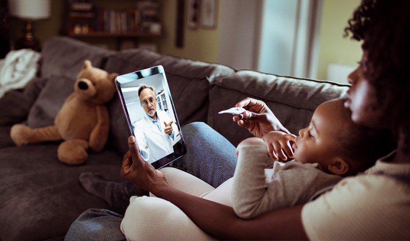 Mom and child on tablet telehealth doctor appointment